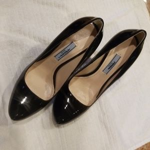 Prada Black Leather Pumps. With signature bag